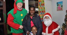 1. Calvin and sister meet Santa at the Short Breaks Service Christmas party