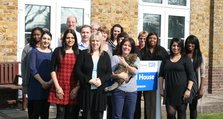 1. Simon Hart (tallest at back) with colleagues from trust headquarters Pinewood House and Henry the cat.