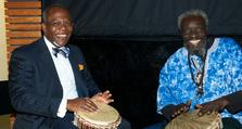 2. Oxleas Medical Director, Dr Ify Okocha (left) joins in with Dogon Music at the 2010 Annual Members' Meeting