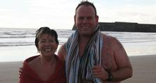 (3) Russell with his mother Jackie who joined him for his November swim at Porthcawl in South Wales