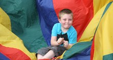 Charlie, 9 enjoying the parachute game
