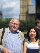 Trust Carer Lead Anna Chan and carer Alan Cork outside the Houses of Parliament.
