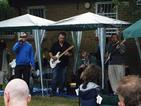 News photo: Singing in the rain at the Bromley ACT/RST's Summer Barbecue.