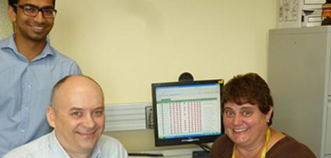 With a Clinical Task List display up on the computer screen are Ravindhar Mittapally, Leslie Hewitt and Liana Pretorius