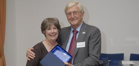 1. Sir Michael Parkinson presents Angela with her glass plaque