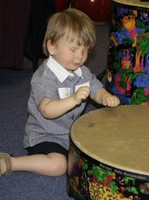 George on the drums in music therapy session
