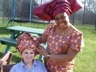 Mental Health Nurse, Maureen Bakare, resplendent in her stunning Nigerian outfit, which included an amazing piece of headgear called a Gele. Maureen had some spare material and made an impromptu Gele for Domestic, Alessandra Salemi.