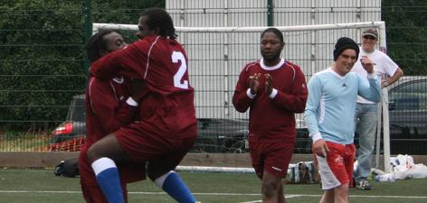 1. Players from the Maroon team celebrate following their 1-0 victory in the final