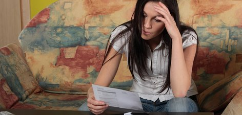 Money and advice: Young woman with bills